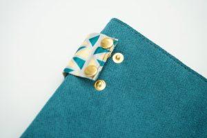 pomegranate blue green clutch